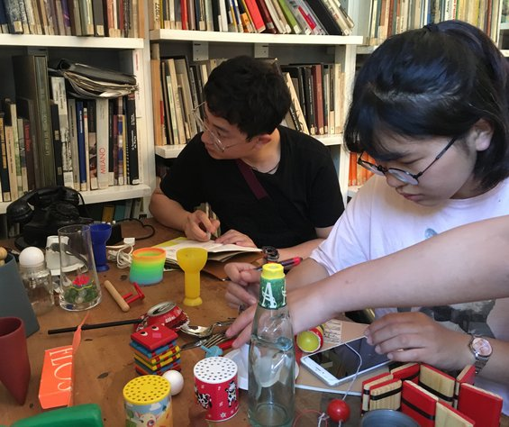 Two CCA students at the Fondazione Achille Castiglioni in Milan, Italy, playing with the master's toys.