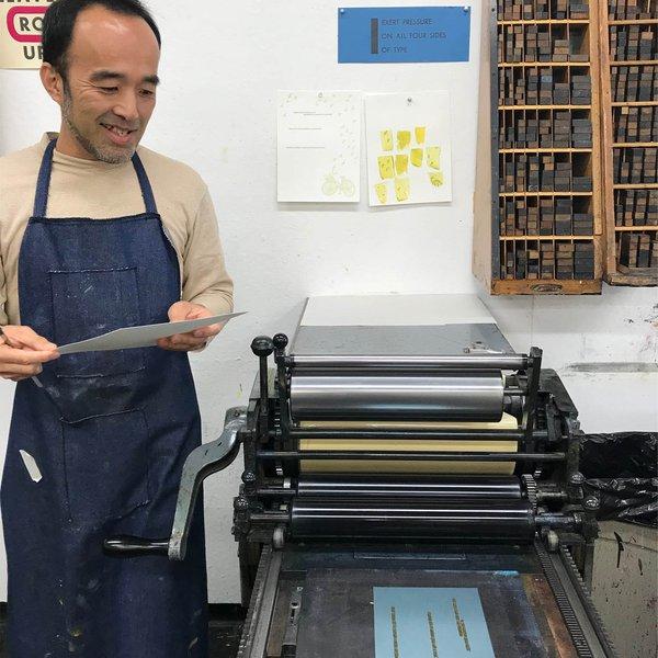 Individualized Studies Professor Taro Hattori is printing on the Vandercook SP15.  Photo credit Printmedia Professor Anthea Black
