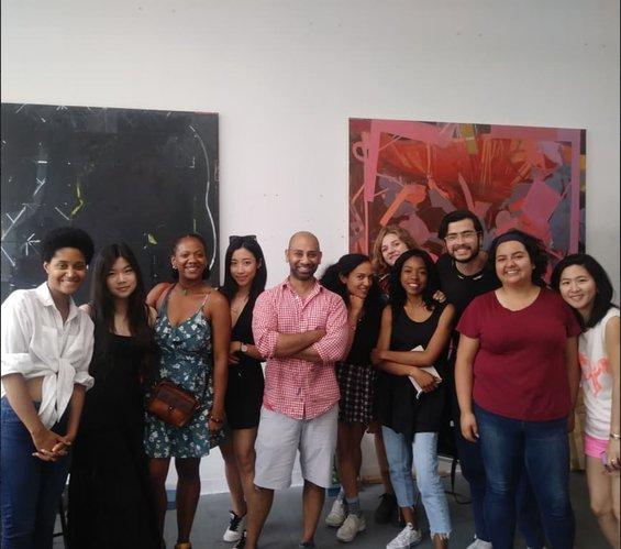 Group of CCA students with artist Sangram Majumdar in his studio, summer 2018