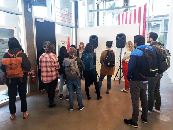 A class visits the Take Action exhibition at the Hubbell Street Galleries in fall 2018.