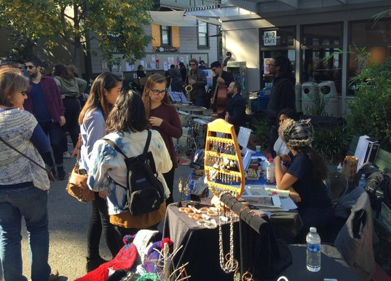 People shopping at the holiday fair on the Oakland Campus at California College of the Arts